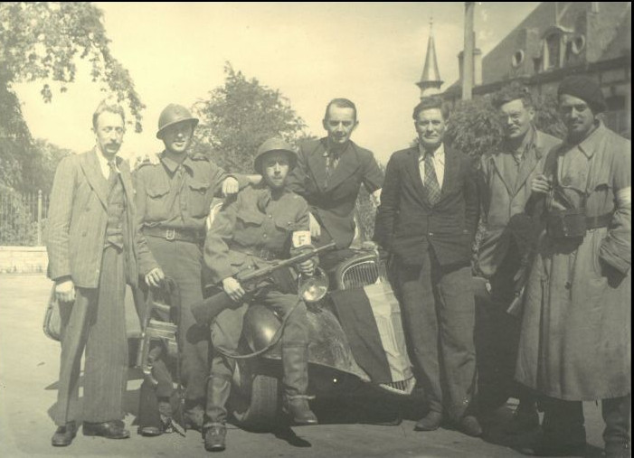 #CRLF#The maquis emerges from the forest on September 3rd, 1944: first picture of finally free men. From left to right: A.Bruniau (Gérard), quartermaster of the Chimay District; A. Van Glabeke (Stan), deputy of Groupe D ; J. Lejour (Mickey), head of the Section Spéciale; F. Delporte (Albert), head of the Chimay District; L. White (Lonnie), American pilot and resistance fighter; M. Hannesson (Marino), American pilot and resistance fighter; M. Franckson (Martial), head of Groupe D.© CegeSoma/State Archives
